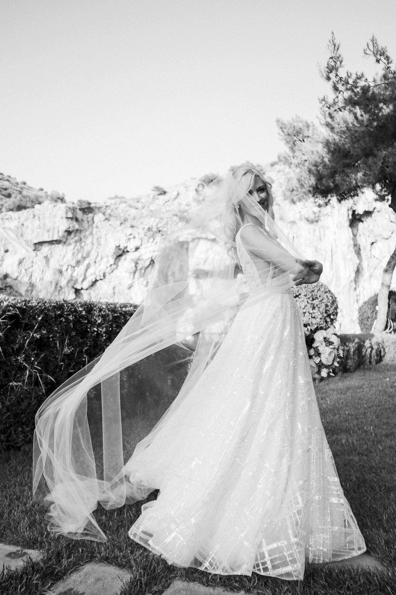 Destination wedding in Greece, bride at Lake Vouliagmeni